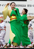 Japanese Festival dancers. Kagoshima City, Japan, April 26, 2008. Dancers in green and yellow yukata kimono performing onstage in the Daihanya Festival held in royalty free stock photo