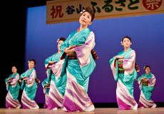 Japanese festival dancers in kimono onstage. Kagoshima City, Japan, October 27, 2007. Japanese dancers in kimono perform onstage in the night portion of the stock photos