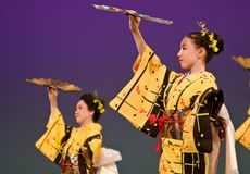 Japanese festival dancers in kimono onstage. Kagoshima City, Japan, October 27, 2007. Japanese dancers in kimono perform onstage in the night portion of the royalty free stock image
