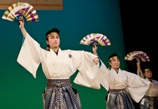 Japanese festival dancers in kimono onstage. Kagoshima City, Japan, October 27, 2007. Japanese dancers in kimono perform with fans onstage in the night portion stock images