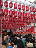Japanese Festival Lanterns. Numerous lanterns hover over crowds for a summer festival in Hiroshima, Japan Stock Photos