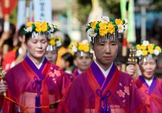 Japanese Festival procession. Kagoshima City, Japan, October 28, 2007. Women in yukata kimono and wearing flowers in their hair lead a procession during the stock image