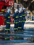 Japanese Firefighters. Kawagoe, Japan - January 20, 2015: A Japanese fire team standing in line following a training exercise Stock Photography