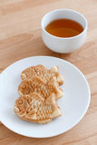Japanese fish-shaped cake with a cup of tea Stock Image