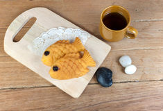 Japanese fish shaped pancake. Taiyaki, japanese fish shaped pancake. Eaten with hot tea on wood table Royalty Free Stock Images