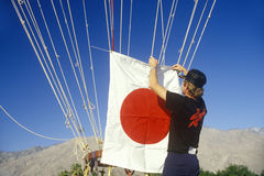 Japanese Flag being tied to hot air balloon in Palm Springs, CA Stock Images