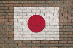 Japanese flag on brick wall Stock Images