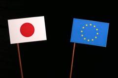 Japanese flag with European Union EU flag  on black. Background Stock Photos