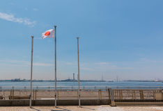 Japanese flag post with landscape of sea and sky. stock image