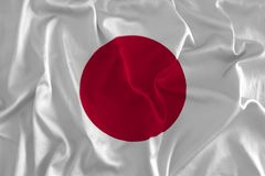 Japanese Flag on Silk Background. Flag of Japan Close-up, Land of the Rising Sun Royalty Free Stock Photos