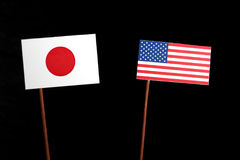 Japanese flag with USA flag  on black Stock Image