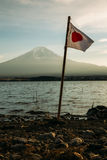 Japanese Flag Beside Water Near Mountain during Daytime Stock Image