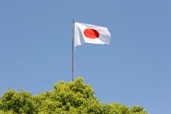 Japanese flag. In wind against clear blue sky Royalty Free Stock Photo