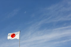 Japanese flag. In wind against clear blue sky Royalty Free Stock Photos