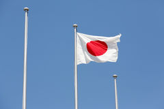 Japanese flag in wind. Against clear blue sky Stock Photography