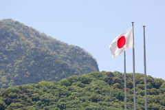 Japanese flag in wind. Against clear blue sky Royalty Free Stock Photography