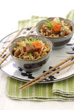 Japanese flavored rice with bamboo shoot. 2 bowls of Japanese flavored rice Takigomi Gohan with mushroom, bamboo shoot, and carrot Stock Photos