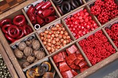 Japanese flea market. Jewellery making elements. Wooden and plastic decorations stock photos