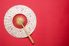 Korean folding fan on red background Stock Image