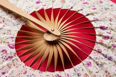 Korean folding fan on red background Royalty Free Stock Photo