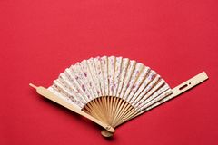 Korean folding fan on red background Stock Images