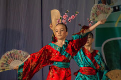 Japanese folk dance at the competition Life in dance in the town of Kondrovo, Kaluga region in Russia in 2016. Royalty Free Stock Photo