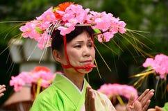 Japanese folk dancer wearing extravagant hat Royalty Free Stock Images