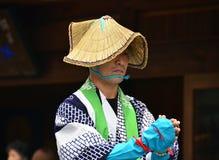 Japanese folk dancer wearing straw hat Stock Image