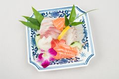 Japanese food. Containing salmon and vegetables Royalty Free Stock Photo