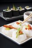 Japanese food. Veggie sushi and rice balls Stock Images