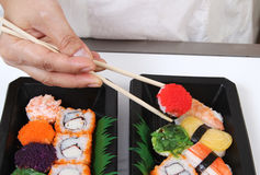 Japanese food. Closeup image of hand and chopstick prepare sushi japanese food Stock Image