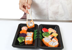 Japanese food. Closeup image of hand and chopstick prepare sushi japanese food Royalty Free Stock Images