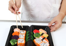 Japanese food. Closeup image of hand and chopstick prepare sushi japanese food Stock Photography