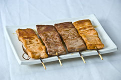Japanese Food 4 Skewers Yakito. Japanese Food,  Menu of 4 Mixed Seafood Skewers, Yakitori   Salmon. Tuna Royalty Free Stock Photos