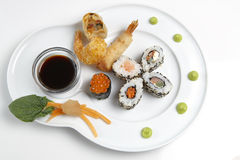 Japanese food. A japanese platter isolated on a white background royalty free stock images