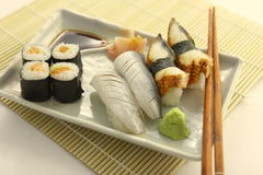 Japanese food. Japanese kitchen. Sushi and rolls on the plate with sticks stock photo
