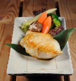 Japanese food. Japanese grill cod fish with vegetable royalty free stock image