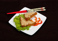 Japanese food. On the black background Royalty Free Stock Images