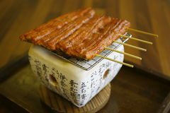 Japanese food. Salmon chargrilled on wooden skewers royalty free stock image