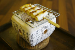 Japanese food. Fish-cake char grilled on wooden skewers Royalty Free Stock Image