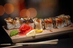 Japanese food. Appetizing sushi on a wooden board. royalty free stock photography