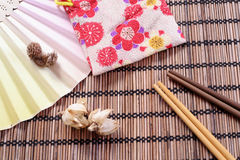 Japanese food background. Chopstick, dried flower stock illustration