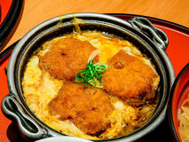 Japanese food called Katsudon in hot pan Royalty Free Stock Images