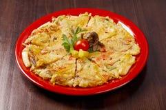 Japanese food close-up Okonomiyaki. Royalty Free Stock Photos