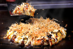 Japanese food : Cooking Okonomiyaki (japan pizza) on pan Stock Photos
