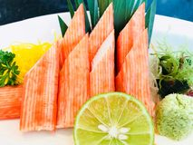 Japanese food. Delicious crab sticks group decorate on white dish prepared for eating in restaurant.  appetizer, asia, breakfast, cook, crab, delicious Royalty Free Stock Photos