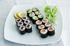 Japanese Food, Eighteen Makis. Japanese Food,  Menu of 18 Mixed Makes- Avocado, Salmon. Tuna PS-44148 Stock Image