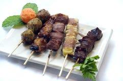 Japanese Food, Five Skewers Ya. Japanese Food,  Plate of 5 Grilled Skewers, Yakitori Meat Balls, Cheese, Chicken, Beef, Pork PS-47850 Stock Images