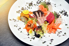 Japanese food, Fresh fish sashimi and rice roll. Stock Photos