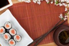 Japanese food and fresh sakura branch Stock Image